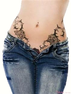girl with black rose tattoo on stomach