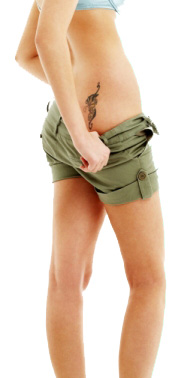 woman with tatoo on lower hip