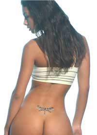 girl with lower back dragonfly tattoo