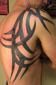 tribal Tattoo on mans shoulder