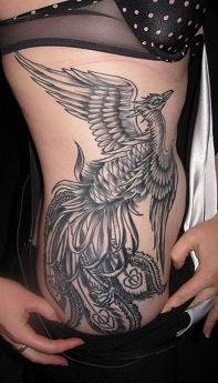 large tattoo of phoenix on womans side